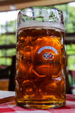 Beer Mug with logo on the table in the Hacker-Pschorr brewery. Munich. Bavaria/ Germany-August 8, 2016: Beer Mug with logo on the table in the Hacker-Pschorr Royalty Free Stock Photos