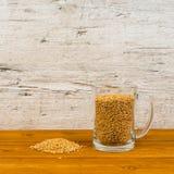 Beer mug with malt on table. Beer mug with malt on wooden table stock images