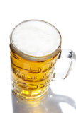 Beer mug. Mug of beer over a white background Stock Photography