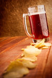 Beer mug and potatoe chips Stock Images