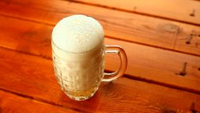 Beer mug pouring stock video