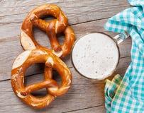 Beer mug and pretzel Stock Photos