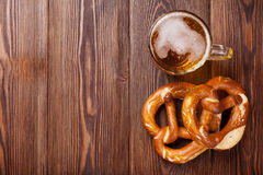 Beer mug and pretzel on wooden table Royalty Free Stock Images