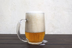 Beer mug on rustic wooden table Stock Images