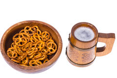Beer in mug and salted bretzels as an appetizer. Studio Photo Royalty Free Stock Photo