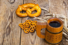 Beer in mug and salted bretzels as an appetizer. Studio Photo Royalty Free Stock Photos