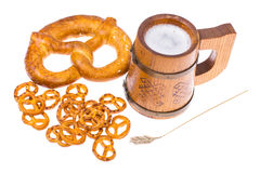 Beer in mug and salted bretzels as an appetizer. Studio Photo Stock Images