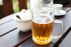 Beer mug on a table in a city restaurant outdoor Stock Photography