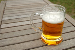 Beer mug on table Royalty Free Stock Photos