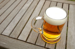 Beer mug on table Royalty Free Stock Photography