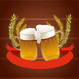 Beer mug on the wooden background Royalty Free Stock Photos