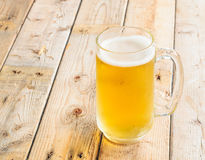 Beer mug on wooden table background Royalty Free Stock Image
