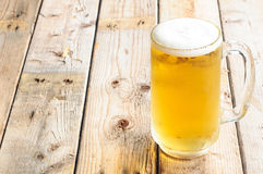 Beer mug on wooden table background Royalty Free Stock Photography