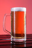 Beer mug on a wooden table Stock Photos