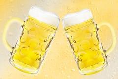 Beer mug on yellow background Drop. Stock Photo