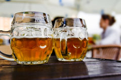 Beer mugs. In outdoor restaurant Royalty Free Stock Image