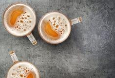 Beer mugs on gray table Stock Photo