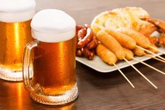 Beer mugs with national german dishes. Oktoberfest traditional food. Beer mugs with national german dishes on background. Oktoberfest traditional food stock photography