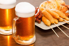 Beer mugs with national german dishes. Oktoberfest traditional food. Beer mugs with national german dishes on wooden background. Oktoberfest Bavarian beer royalty free stock photo