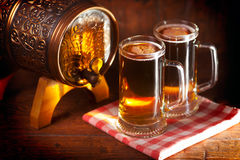 Beer mugs and small barrel Royalty Free Stock Image