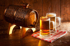 Beer mugs and small barrel Royalty Free Stock Photos