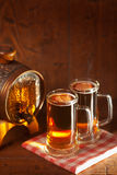 Beer mugs and small barrel Stock Images