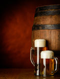 Beer Mugs on wooden table royalty free stock image