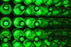 Beer museum. Bottles as background green beer texture Royalty Free Stock Photos