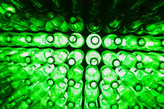 Beer museum. Bottles as background green beer texture Royalty Free Stock Photography