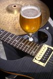 Beer and music equipment. Glass full of light beer standing on a case with some music equipment Royalty Free Stock Photography