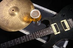 Beer and music equipment. Glass full of light beer standing on a case with some music equipment Royalty Free Stock Photos