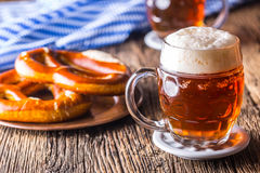 Beer and Oktoberfest. Draft beer pretzel and blue checkered tablecloth as traditional products for bavarian festival oktoberfest Stock Images