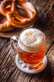 Beer and Oktoberfest. Draft beer pretzel and blue checkered tablecloth as traditional products for bavarian festival oktoberfest.  Royalty Free Stock Photo