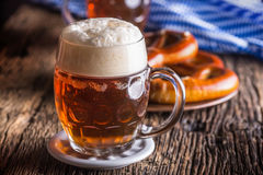 Beer and Oktoberfest. Draft beer pretzel and blue checkered tablecloth as traditional products for bavarian festival oktoberfest Stock Photo