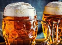Beer. Oktoberfest.Two cold beers. Draft beer. Draft ale. Golden beer. Golden ale. Two gold beer with froth on top. Draft cold beer. In glass jars in pub hotel stock photo