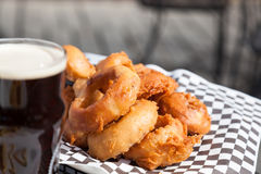 Beer and Onion Rings on Outdoor Patio Table Royalty Free Stock Photography