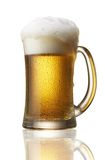 Beer over flow. Beer in mug with foam over flow Royalty Free Stock Photography