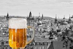 Beer with the panorama of Prague Royalty Free Stock Image
