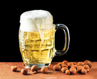 Beer and peanuts Royalty Free Stock Photos