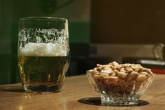 Beer and peanuts for St Patrick day stock images