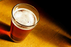 Beer pint. Pint of amber beer, near bubbles are sharp royalty free stock image