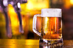 Beer pint. With blurred golden background. Shot in traditional pub royalty free stock photos