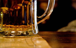 Beer pint. On a wooden table stock image