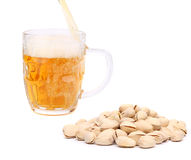 Beer and pistachios Stock Photos
