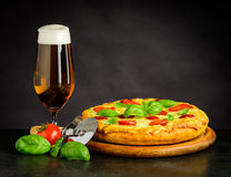 Beer and Pizza. Tasty looking Beer and Pizza Margherita Royalty Free Stock Images