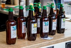 Beer in plastic bottles stand on outdoor showcase royalty free stock photos