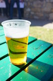 Beer in plastic cup Royalty Free Stock Photos