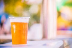 Beer in a plastic cup. Plastic cup of beer, Disposable glass royalty free stock images