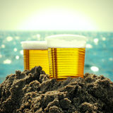 Beer in Plastic Cups Royalty Free Stock Images