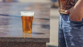 Beer in a plastic glass in the city.  stock photos
